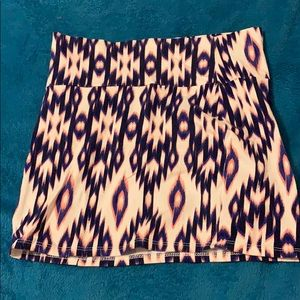 White pencil skirt with Aztec pattern.